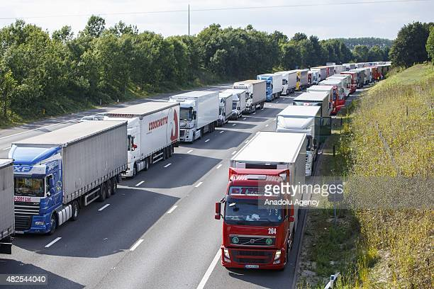 Thousands of lorries backed up for miles on their way to Channel Tunnel on M20 in Kent England as part of Operation Stack on July 31 2015 Operation...