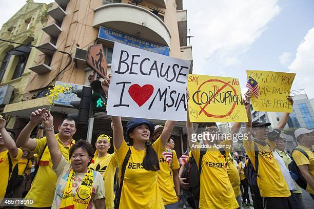 Thousands of Malaysians wearing banned yellow Tshirts take part in the BERSIH 4 rally organized by BERSIH to demand institutional reforms and the...