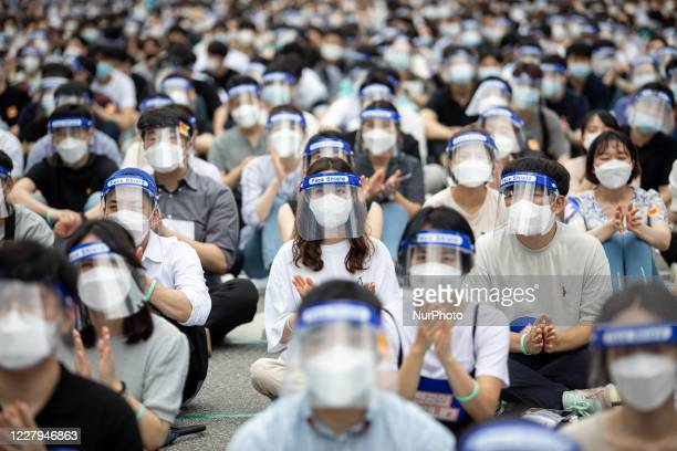 Thousands of medical students and doctors with the Korean Intern Resident Association gather for a rally against the government's plan to raise the...