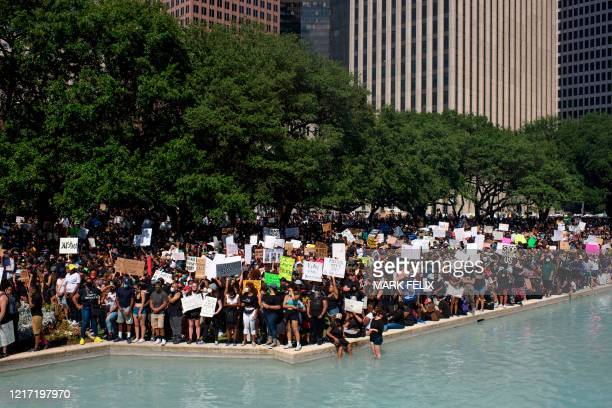 Thousands of members of the community gathered to mourn the death of George Floyd during a march across downtown Houston Texas on Tuesday June 2 2020...