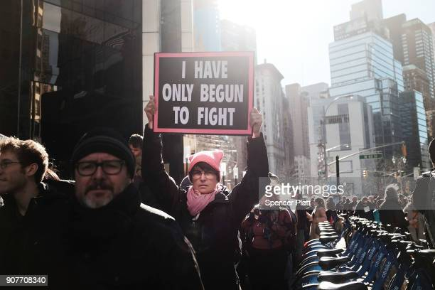 Thousands of men and women hold signs and rally while attending the Women's March on January 20, 2018 in New York, United States. Across the nation...