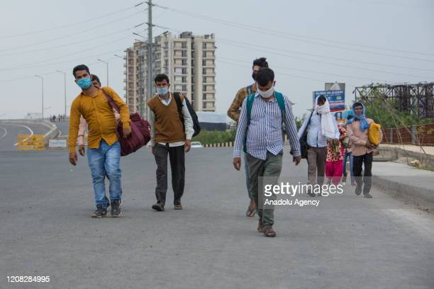 Thousands of migrant labour workers stranded in Delhi starts walking to reach their home in different parts of the country during the complete...