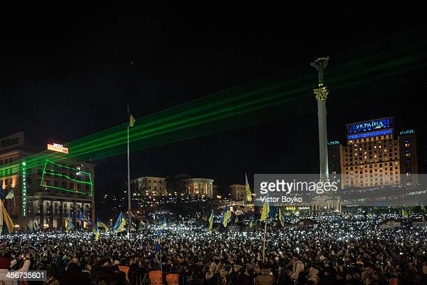 Thousands of mobile phone flashlights light up the Maidan Square as rock band Okean Elzy perform live on stage on December 14 2013 in Kiev Ukraine...