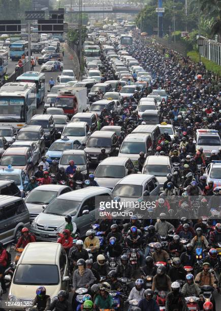 Thousands of motorists sit stuck in the morning gridlock after a group of protesters blocked one of Jakarta's main roads on February 22 2010 The...