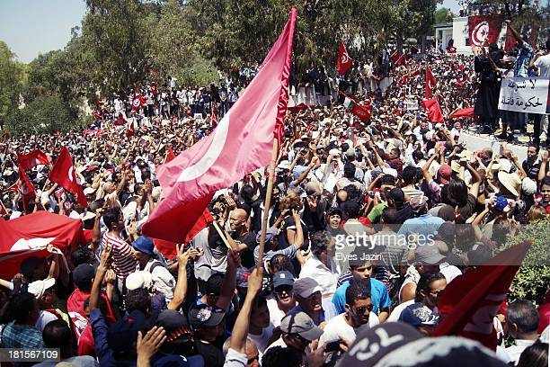 Thousands of mourners and protestors attended the national funeral of Mr Brahmi Mohamed , who has been killed thursday, the Tunisian republic day, by...