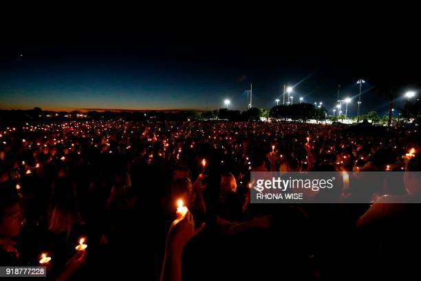Thousands of mourners attend a candlelight vigil for victims of Marjory Stoneman Douglas High School shooting in Parkland Florida on February 15 2018...
