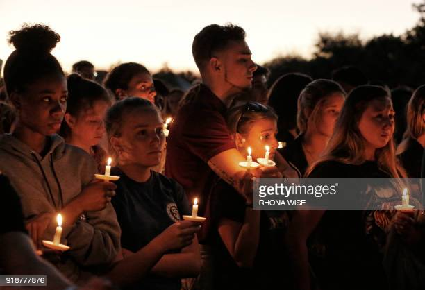Thousands of mourners attend a candlelight vigil for victims of the Marjory Stoneman Douglas High School shooting in Parkland Florida on February 15...