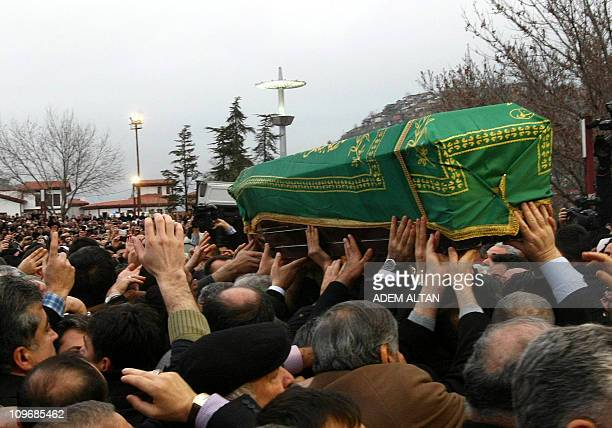 Thousands of mourners chanting Allahu Akbar carry the coffin of late Turkish Prime Minister Necmettin Erbakan as they flock to a mosque in Istanbul...