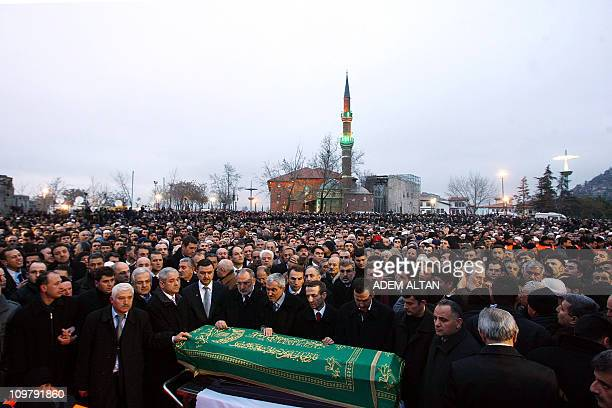 Thousands of mourners chanting Allahu Akbar pray in front of the coffin of late Turkish Prime Minister Necmettin Erbakan as they flock to a mosque in...