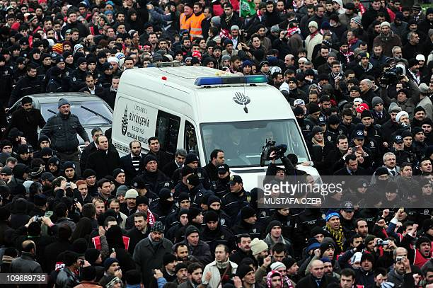 Thousands of mourners gather on the streets of Istanbul for the funeral of Turkey's former Prime Minister Necmettin Erbakan on March 1 2011 Turkey's...