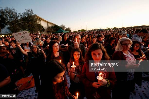 TOPSHOT Thousands of mourners hold candles during a candlelight vigil for victims of the Marjory Stoneman Douglas High School shooting in Parkland...