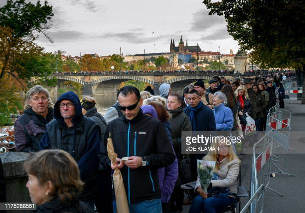 Thousands of mourners queue on a bridge to pay their last respects to late Czech singer Karel Gott in Prague on October 11 2019 Czech pop singer...