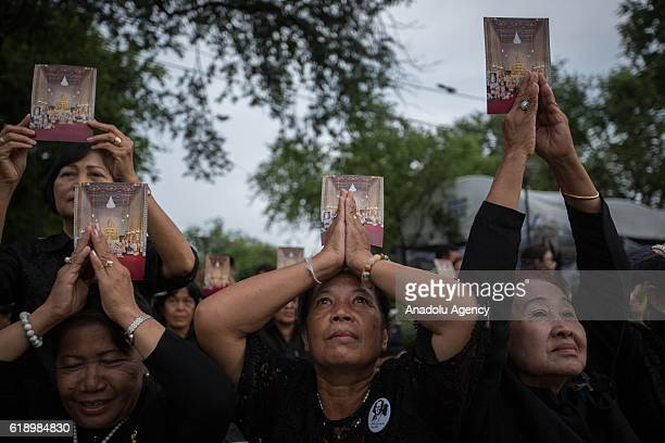 Thousands of mourners queue up at Sanam Luang as they wait to enter Grand Palace to pay respect for the first time before the Royal Hall urn...
