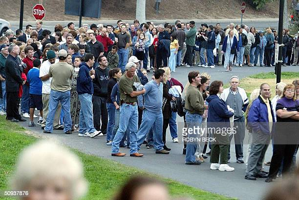Thousands of mourners wait in a line approximately 15 miles long at Moorpark College in Moorpark California to board buses that will take them to see...