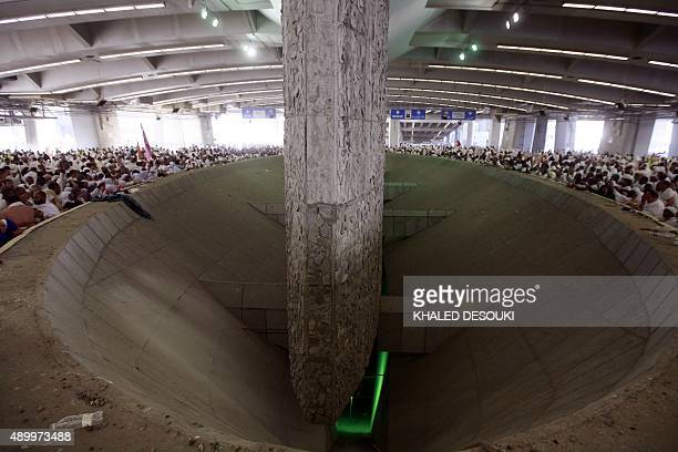 Thousands of Muslim pilgrims cast stones at a pillar symbolising stoning Satan in a ritual called Jamarat the last and most dangerous rite of the...