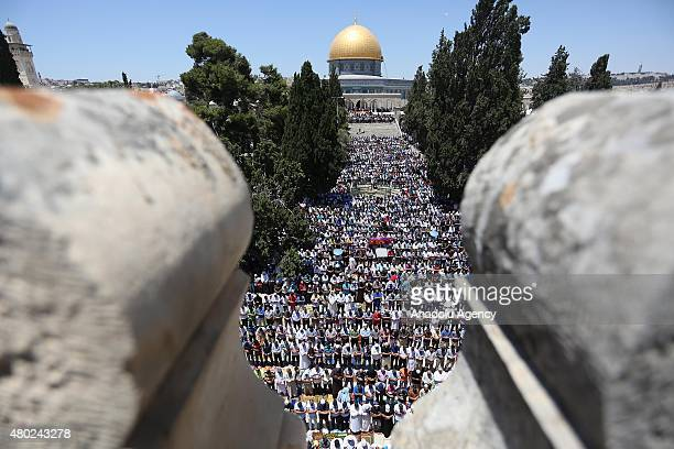 Thousands of Muslims perform the last Friday prayer of the Islam's holy fasting month of Ramadan at AlAqsa Mosque on July 10 2015 in the Old City of...