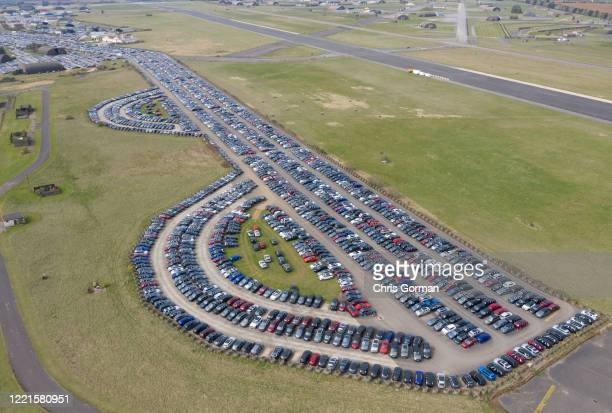 Thousands of new and used cars stored at Upper Heyford aerodrome on April 08 2020 in Bicester Oxfordshire Airfields have traditionally been used to...