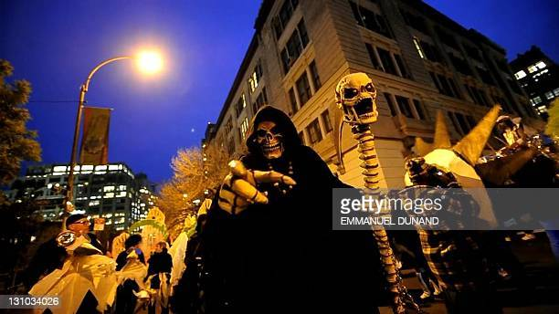 Thousands of New Yorkers descend onto the streets to take part in the annual Halloween parade in Greenwich village New York on October 31 2011