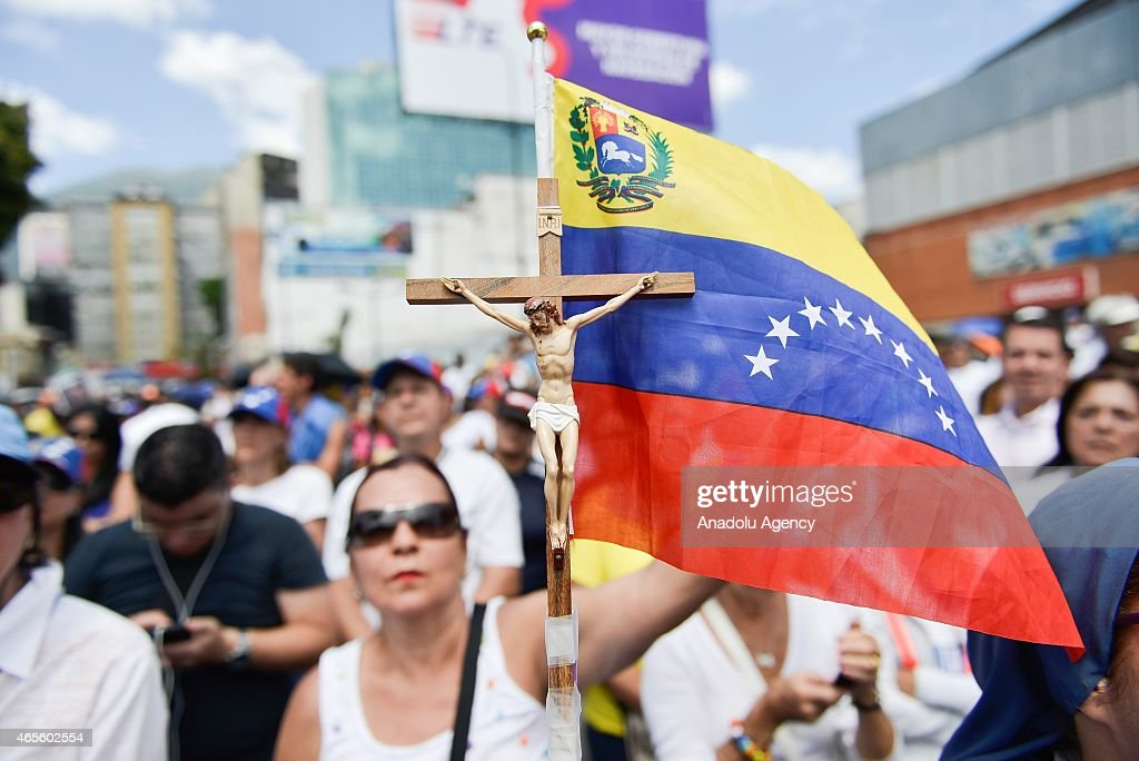 Thousands of opponents of the government of President Nicolas Maduro march in Caracas to mark International Women's Day on March 8, 2015.
