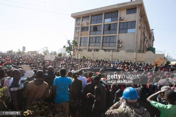 Thousands of Opposition parties supporters participate in a protest march in the capital Lilongwe on June 20 to force Malawi Electoral Commission...
