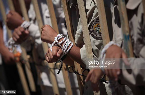 Thousands of Palestinian children take part in a solidarity demonstration for Palestinian prisoners going on a hunger strike in Israeli jails in Gaza...