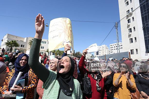 Thousands of Palestinian teachers hold banners and shout sloganprotest in front of Council of Ministers building demanding a salary hike from the...