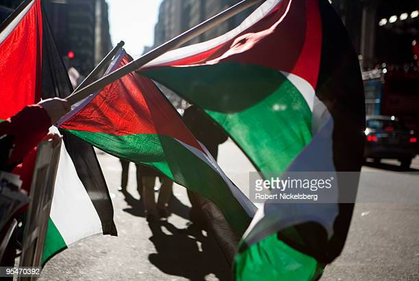 Thousands of PalestinianAmericans assembled and waved Palestinian flags December 27 2009 to protest the one year anniversary of the Israeli Army's...