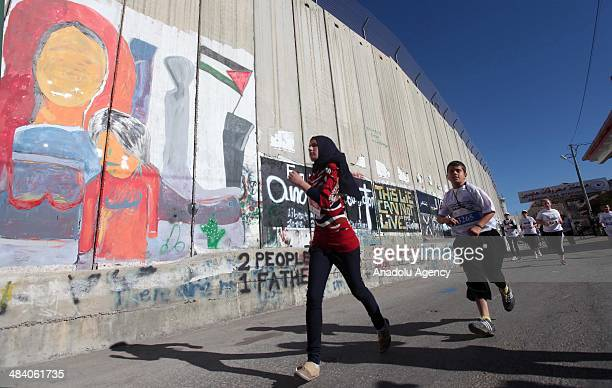 Thousands of Palestinians Arabs and foreign athletes join to second International Palestine Marathon organised for Palestine Sports Day in Bethlehem...