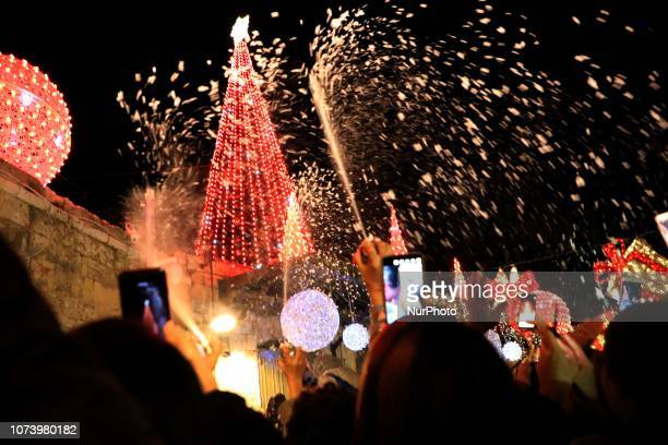 Thousands of Palestinians in East Jerusalem, Israel, lit up the Christmas tree on Saturday 15 December 2018, marking the start of celebrations for...