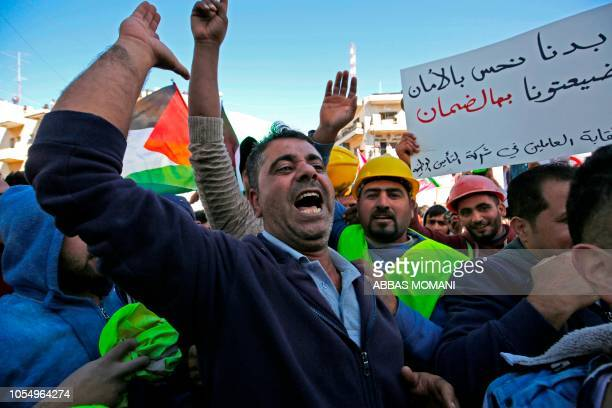 TOPSHOT Thousands of Palestinians some waving national flags take part in a protest against a social security law proposed by the Paleslitnian...