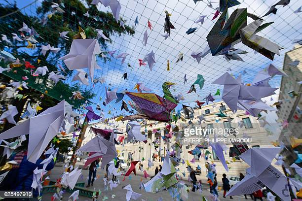 Thousands of paper birds installed by the Spanish section of the World Wildlife Fund are seen in front of the Parliament in Madrid on November 24 as...