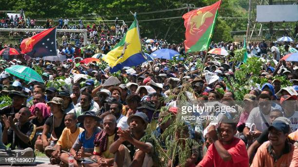 Thousands of Papua New Guineans protest against the government's plan to delay national elections during a rally in Port Moresby on April 10 2012...