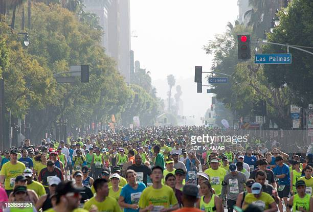 Thousands of participants run down Hollywood boulevard during the annual Asics LA Marathon on March 17 2013 in Hollywood California The marathon...