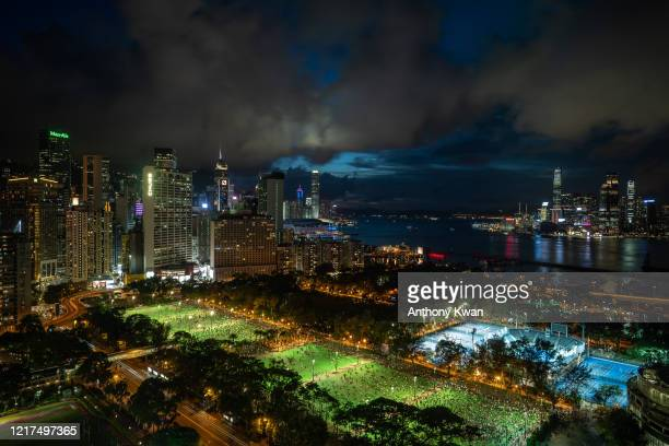 Thousands of participants take part in a memorial vigil in Victoria Park on June 4, 2020 in Hong Kong, China. Thousands gathered for the annual...