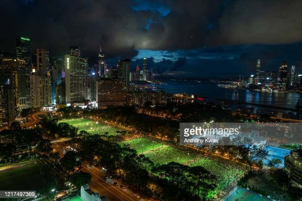 Thousands of participants take part in a memorial vigil in Victoria Park on June 4 2020 in Hong Kong China Thousands gathered for the annual memorial...