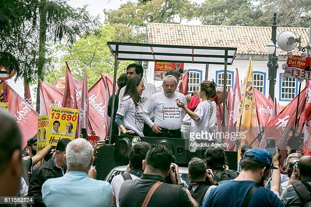 Thousands of people accompany the former President of Brazil, Luis Inacio da Silva who takes part in the last day of his party candidate's campaign...