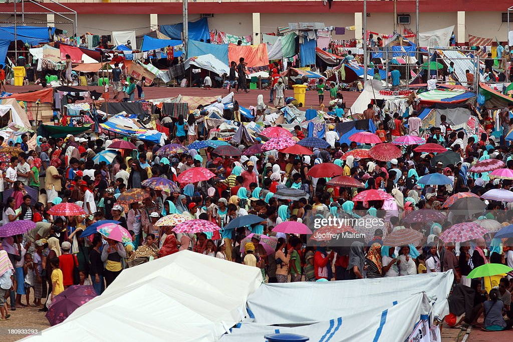 Thousands of people are seen inside the sports complex turned evacuation centre as figting resumes on September 18, 2013 in Zamboanga, Philippines. Around 100 have been killed, six of them from the military, three from police and seven civilians, as a standoff between Muslim rebels and state security forces have resumed. The military said the rebels, numbering 30 to 40, are still holding dozens of hostages. The conflict that displaced around 100,000 people began on September 9, 2013, weeks after Nur Misuari, the leader and founder of the Moro National Liberation Front, declared the independence of Mindanao. His group signed a peace accord with government in 1996.