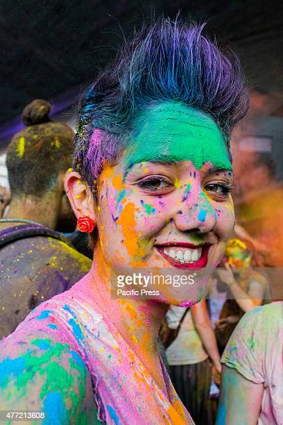 Thousands of people at the second edition of the Turin Holi Fusion, the Festival of Colors of Indian origin. In photo a beautiful color girl.