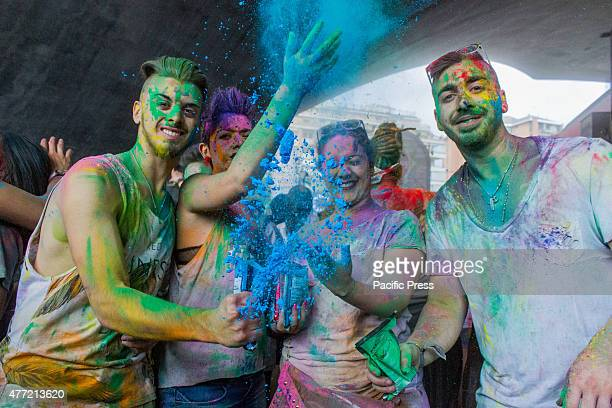 Thousands of people at the second edition of the Turin Holi Fusion, the Festival of Colors of Indian origin. Boys throwing colors in the air.