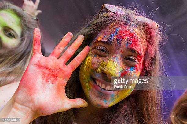 Thousands of people at the second edition of the Turin Holi Fusion, the Festival of Colors of Indian origin. In photo a girl colored in the face.