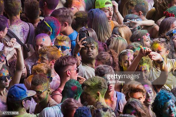 Thousands of people at the second edition of the Turin Holi Fusion, the Festival of Colors of Indian origin. An Indian boy take a selfie into the...