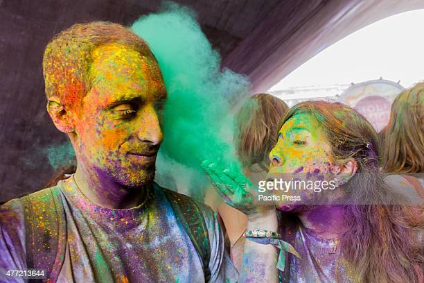 Thousands of people at the second edition of the Turin Holi Fusion, the Festival of Colors of Indian origin. In the photo a girl blows the color in...