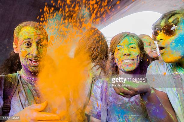 Thousands of people at the second edition of the Turin Holi Fusion, the Festival of Colors of Indian origin. In photo some friends play with colors.
