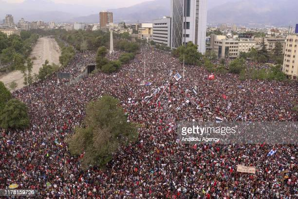 Thousands of people attend a demonstration to request the resignation of Chilean President Sebastian Pinera in the area surrounding Plaza Italia in...