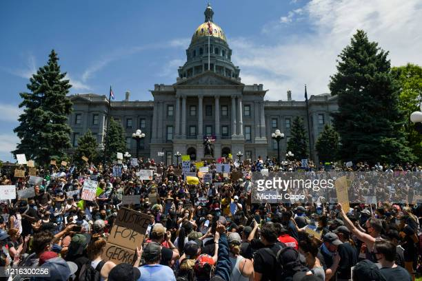 Thousands of people attend a rally next to the Colorado State Capitol to protest the death of George Floyd on May 30, 2020 in Denver, Colorado. The...