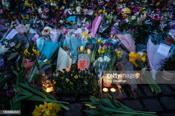 Thousands of people attend a vigil at Clapham Common bandstand to pay their respects and lay flowers in memory of Sarah Everard on March 13, 2021 in...