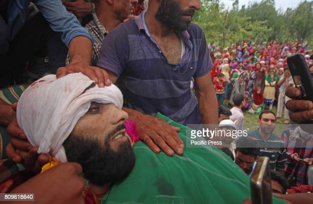 Thousands of people attend the funeral prayers of Jehangir Ahmad Khanday of Keller area of Shopian district Six homes were destroyed during a...