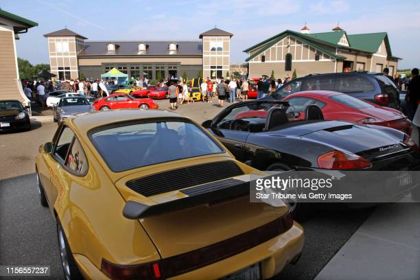 Thousands of people attended the open house, showcasing cars of every make and type at the AutoMotorPlex in Chanhassen, August 6th, 2011. People are...