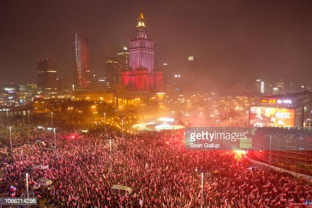Thousands of people bearing Polish flags converge on the March of Independence during events to mark the 100th anniversary of the reinstatement of...
