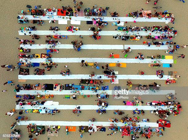 Thousands of people bring their dinner on improvised table of quotThe longest dinner on the beachquot on the Asparuhovo beach in the Black sea town...